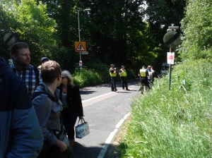 Police watching over the entrance queue